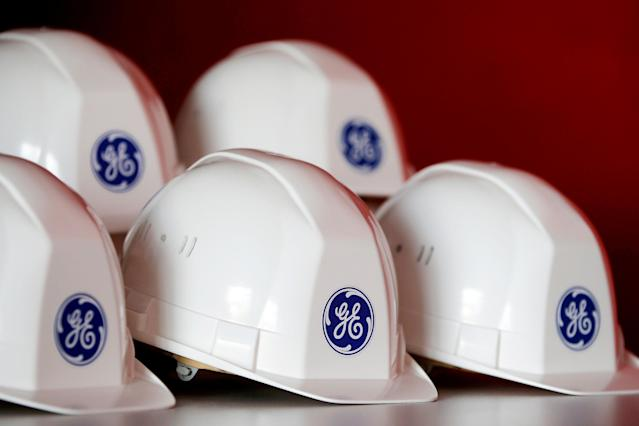 The General Electric logo is pictured on working helmets during a visit at the General Electric offshore wind turbine plant in Montoir-de-Bretagne, near Saint-Nazaire, western France, November 21, 2016. REUTERS/Stephane Mahe