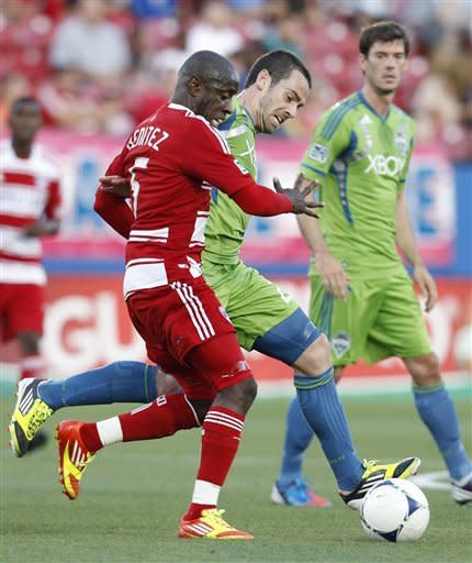 FC Dallas's Jair Benitez, front, and Seattle Sounders' Zach Scott, rear, compete for control of the ball in the first half of an MLS soccer game, Wednesday, May 9, 2012, in Frisco, Texas. (AP Photo/Tony Gutierrez