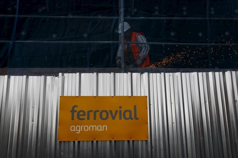 FILE PHOTO: A welder works at a Ferrovial construction site, of new residential buildings, in Madrid
