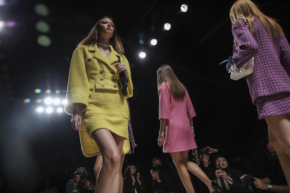 Models wear creations for the Chanel Spring-Summer 2022 ready-to-wear fashion show presented in Paris, Tuesday, Oct. 5, 2021. (Photo by Vianney Le Caer/Invision/AP)