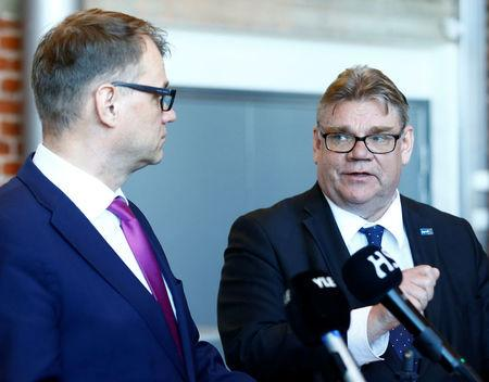 Finland's Prime Minister Juha Sipila (L) listens to Foreign Minister Timo Soini after government's open session for members of public took place during the celebration of the 100th anniversary of Finnish independence in Porvoo, Finland May 4, 2017. REUTERS/Ints Kalnins