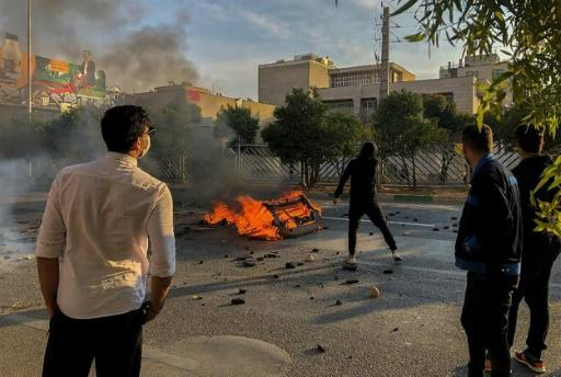 Iranian protesters block a road during a demonstration against an increase in gasoline prices in the central city of Shiraz on November 16, 2019