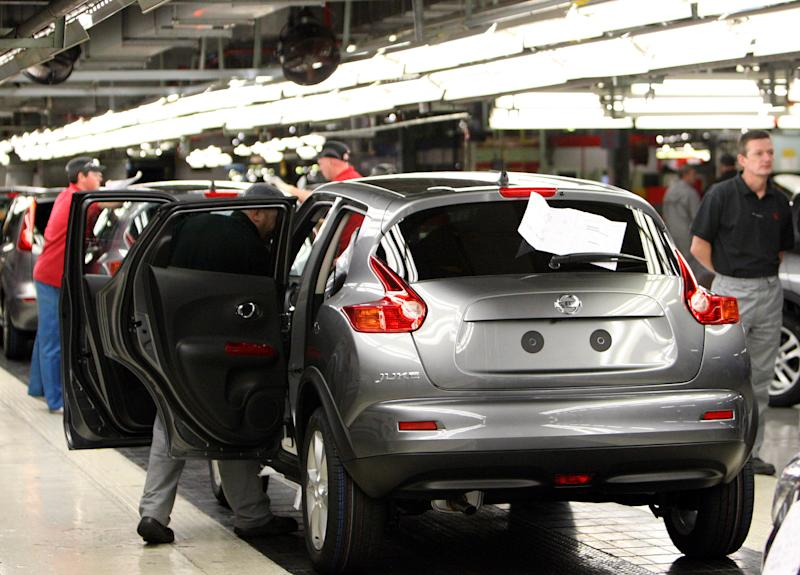 Workers are seen on the assembly line for the Nissan Juke, at the Nissan car factory in Sunderland, England, Thursday, Aug. 26, 2010. (AP Photo/Scott Heppell)