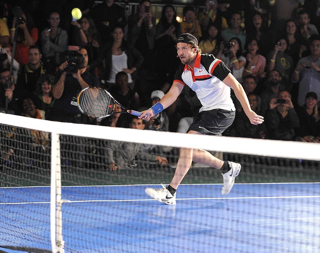 """At Wednesday's Nike Primetime Knockout tennis event, stars including Bradley Cooper and model Bar Refaeli got to hit the court for doubles matches with tennis greats such as Roger Federer, Rafael Nadal, and Serena Williams. Dimitrios Kambouris/<a href=""""http://www.wireimage.com"""" target=""""new"""">WireImage.com</a> - August 25, 2010"""
