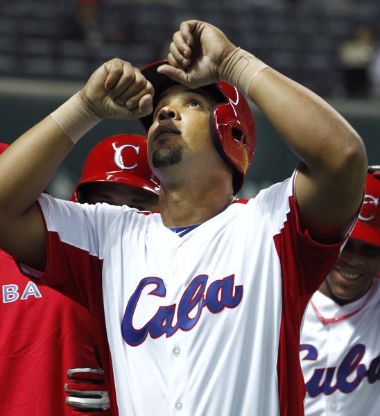 Cuba's first baseman Jose Abreu reacts after hitting a grand slam off China's Liu Yu in the fifth inning of their World Baseball Classic first round game in Fukuoka, Japan, Monday, March 4, 2013. (AP Photo/Koji Sasahara)