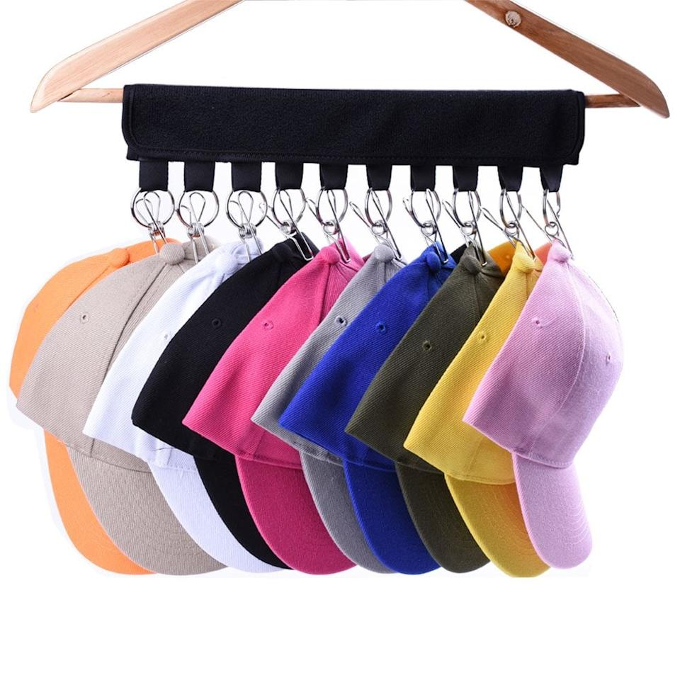 "<p>This <a href=""https://www.popsugar.com/buy/Cap-Organizer-Hanger-469239?p_name=%20Cap%20Organizer%20Hanger&retailer=amazon.com&pid=469239&price=8&evar1=casa%3Aus&evar9=46390211&evar98=https%3A%2F%2Fwww.popsugar.com%2Fhome%2Fphoto-gallery%2F46390211%2Fimage%2F46390478%2FCap-Organizer-Hanger&list1=shopping%2Corganization%2Chome%20organization%2Chome%20shopping&prop13=api&pdata=1"" rel=""nofollow"" data-shoppable-link=""1"" target=""_blank"" class=""ga-track"" data-ga-category=""Related"" data-ga-label=""https://www.amazon.com/dp/B07FLNLVF6/ref=dp_cerb_1"" data-ga-action=""In-Line Links""> Cap Organizer Hanger</a> ($8) is genius.</p>"