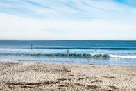 """<p><strong>Let's start big picture here.</strong><br> This untamed shoreline is one of San Diego's wildest beaches. Secluded by sand dunes, the vast stretch of sand provides a perfect canvas for countless water sports and activities.</p> <p><strong>Any standout features or must-sees?</strong><br> The beach volleyball courts are a hit with active crowds (bring your own net and ball), while the fire pits (propane only) are an allure for nighttime beachgoers. For post-beach nourishment, make the short drive to <a href=""""https://www.cntraveler.com/restaurants/san-diego/san-diego/buona-forchetta?mbid=synd_yahoo_rss"""" rel=""""nofollow noopener"""" target=""""_blank"""" data-ylk=""""slk:Buona Forchetta"""" class=""""link rapid-noclick-resp"""">Buona Forchetta</a>, the wildly popular Neapolitan pizza and pasta eatery with Italian roots and a location in nearby Encinitas.</p> <p><strong>Was it easy to get around?</strong><br> There are restrooms and showers here, as well as lifeguard towers. While street parking is limited here, a nearby paid lot is another available option. Keep in mind there are no businesses within sight of the beach—part of the appeal—so pack in whatever you'll need for the day.</p> <p><strong>All said and done, what—and who—is this best for?</strong><br> The perfect pairing of wild beach and easy accessibility make South Ponto ideal for both large groups hauling a lot of stuff, and families with children, though just about everyone can find a reason to love this spot.</p>"""