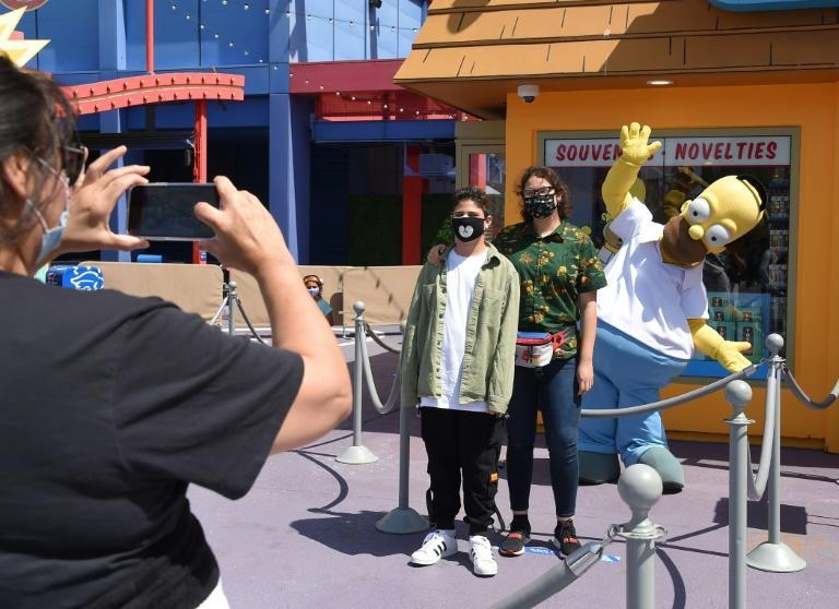 Characters who used to roam Universal Studios Hollywood posing for photos with guests are still absent -- one giant Homer Simpson danced behind a rope designating a special, social-distanced selfie zone
