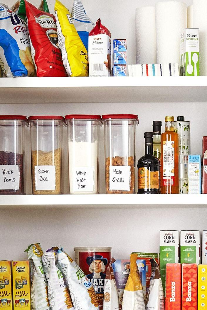 """<p>Stock shelves like the grocery store does. By placing the newest boxes, containers, and cans behind the older stuff, you'll use the older food first. Keep stock of what you actually have by placing <a href=""""https://www.goodhousekeeping.com/health/diet-nutrition/g5147/healthy-canned-foods/"""" rel=""""nofollow noopener"""" target=""""_blank"""" data-ylk=""""slk:dry foods"""" class=""""link rapid-noclick-resp"""">dry foods</a> (including cereals, beans, nuts, and flour) in labeled containers. </p><p><a class=""""link rapid-noclick-resp"""" href=""""https://www.amazon.com/Shazo-Storage-Containers-20-Piece-Container/dp/B075MT6GQS/?tag=syn-yahoo-20&ascsubtag=%5Bartid%7C10060.g.36311015%5Bsrc%7Cyahoo-us"""" rel=""""nofollow noopener"""" target=""""_blank"""" data-ylk=""""slk:SHOP STORAGE CONTAINERS"""">SHOP STORAGE CONTAINERS</a></p>"""