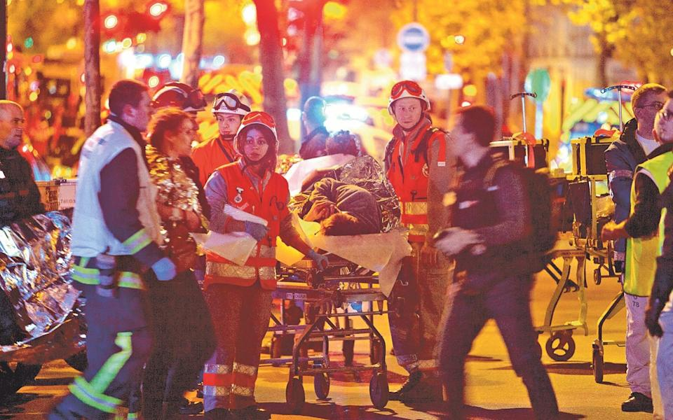 Paramedics take care of the wounded at the Bataclan - Getty Images