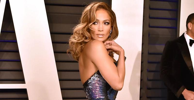 J Lo poses at an event