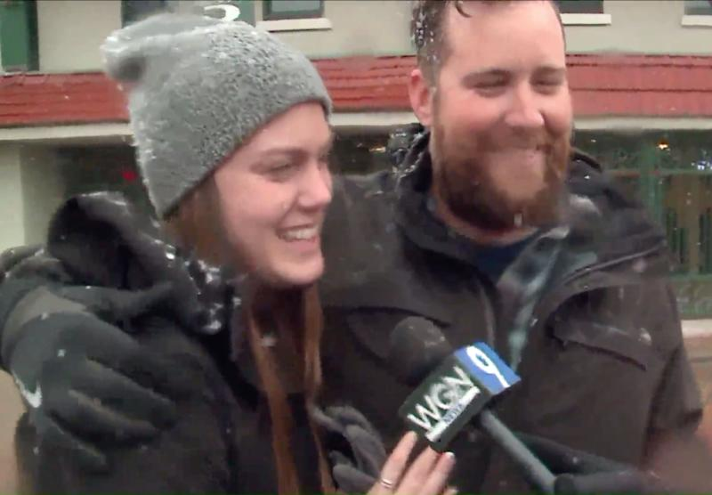 Clinton Parkinson and Clohe Ludwig talk to a reporter from WGN after the camera crew accidentally caught their engagement on camera. (Credit: WGN)
