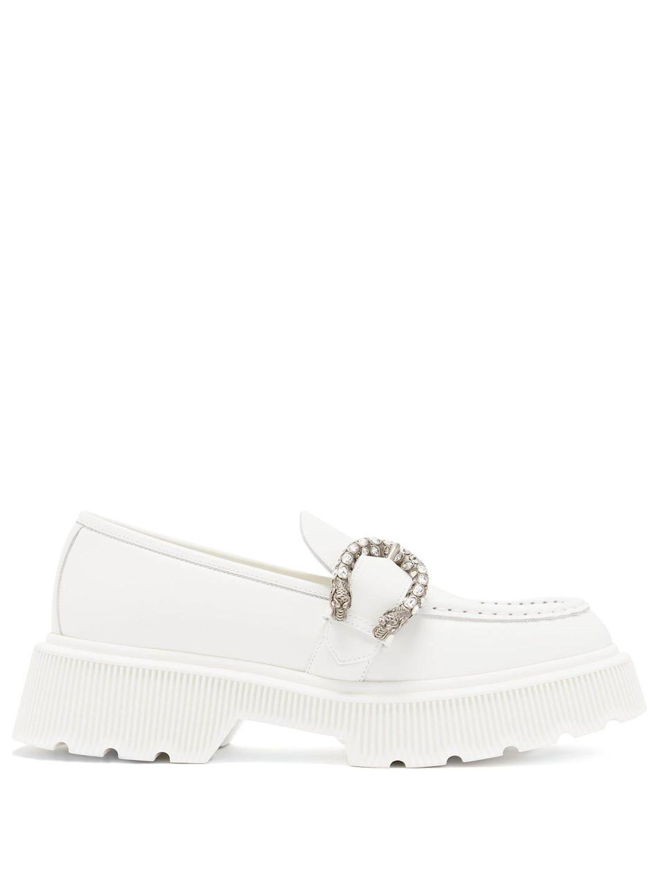 """<p><strong>Gucci</strong></p><p>matchesfashion.com</p><p><strong>$980.00</strong></p><p><a href=""""https://go.redirectingat.com?id=74968X1596630&url=https%3A%2F%2Fwww.matchesfashion.com%2Fus%2Fproducts%2F1361010&sref=https%3A%2F%2Fwww.harpersbazaar.com%2Fwedding%2Fbridal-fashion%2Fg36113322%2Fwedding-flats-for-brides%2F"""" rel=""""nofollow noopener"""" target=""""_blank"""" data-ylk=""""slk:SHOP NOW"""" class=""""link rapid-noclick-resp"""">SHOP NOW</a></p><p>Catch a more modern vibe—that still feels bridal—with a pair of buckle leather loafers. Appropriately, these were inspired by the ancient Greek god of festivity and theatre.</p>"""