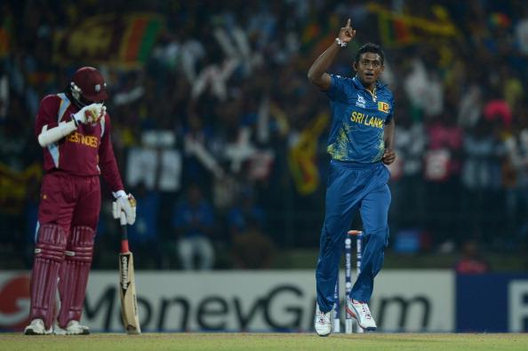 KANDY, SRI LANKA - SEPTEMBER 29:  Ajantha Mendis of Sri Lanka celebrates dismissing Johnson Charles of the West Indies during the  ICC World Twenty20 2012 Super Eights Group 1 match between Sri Lanka and the West Indies at Pallekele Cricket Stadium on September 29, 2012 in Kandy, Sri Lanka.  (Photo by Gareth Copley/Getty Images,)
