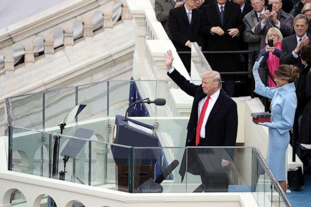 PHOTO: President Donald Trump and his wife Melania Trump wave after he took the oath of office on the West Front of the Capitol on Jan. 20, 2017. (Drew Angerer/Getty Images, FILE)