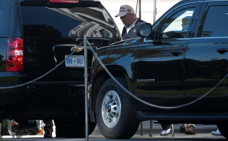 President Donald Trump walks to his motorcade outside the White House on November 8, 2020, headed again to a nearby golf course a day after US networks declared his loss to Democrat Joe Biden