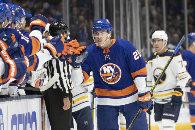 New York Islanders left wing Michael Dal Colle (28) celebrates his first period goal during an NHL hockey game against the Buffalo Sabres, Saturday, Dec. 14, 2019 in Uniondale, N.Y. (AP Photo/Mark Lennihan)
