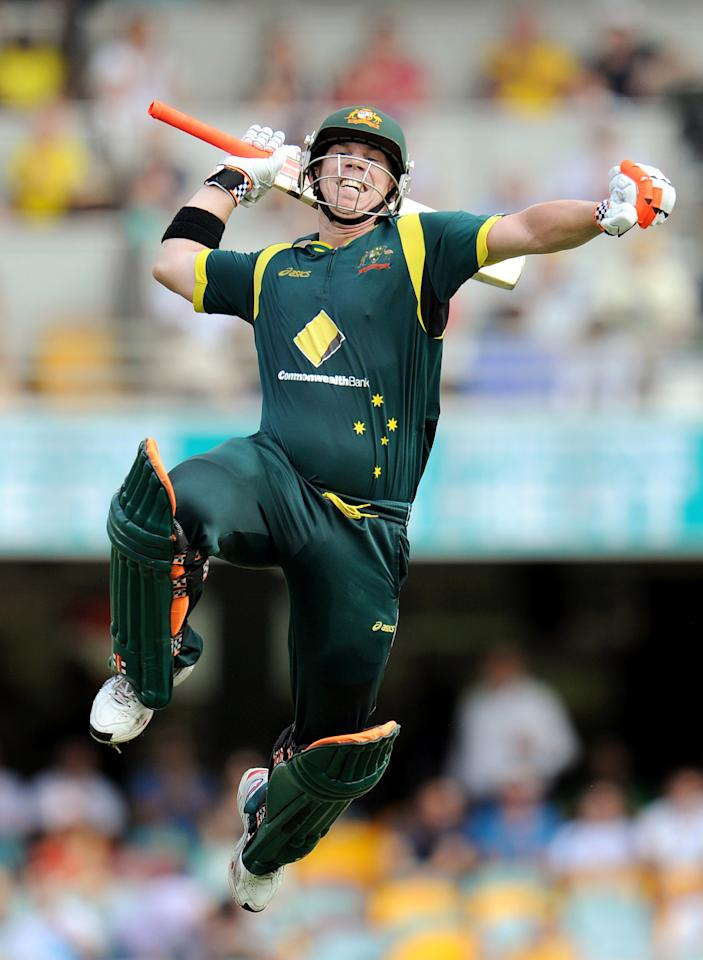 Australian batsman David Warner leaps high in the air as he celebrates his century against Sri Lanka in the first international one-day cricket final at the Gabba in Brisbane on March 4, 2012.  IMAGE STRICTLY RESTRICTED TO EDITORIAL USE - STRICTLY NO COMMERCIAL USE  AFP PHOTO/William WEST (Photo credit should read WILLIAM WEST/AFP/Getty Images)
