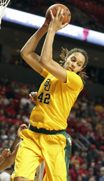 Baylor's Brittney Griner grabs a rebound against Texas Tech during an NCAA college basketball game in Lubbock, Texas, Wednesday, Jan. 30, 2013. (AP Photo/Zach Long)