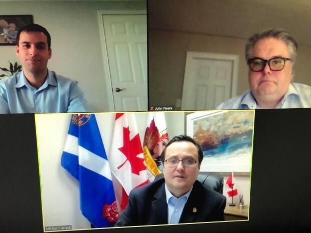 Jay Aird from John O's Foods Inc. and John Neate of Great Lakes Food Company of Chatham are seen in a screenshot from the funding announcement with Windsor-Tecumseh MP Irek Kusmierczyk on April 7.