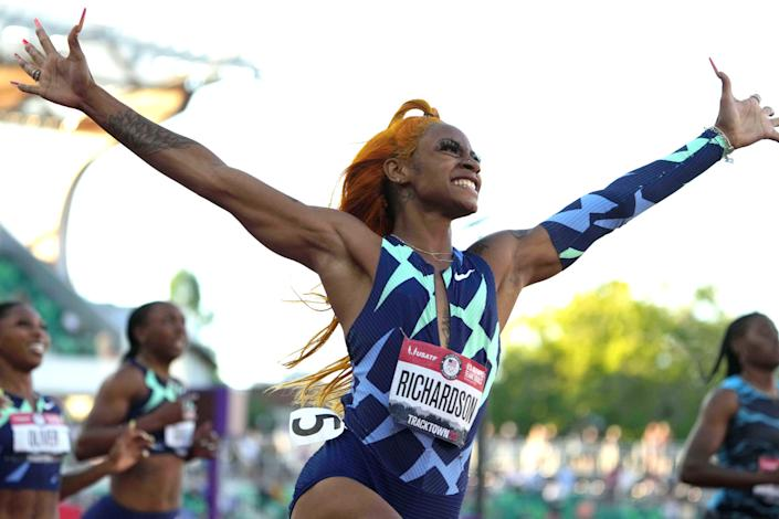 Richardson celebrates after winning the women's 100m at Olympic trials.
