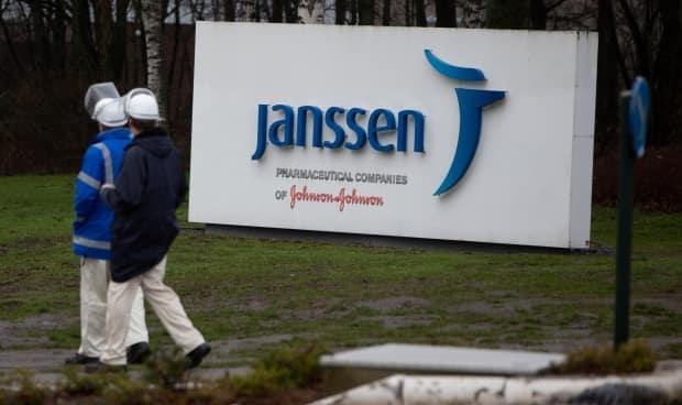 Workers walk outside Johnson & Johnson subsidiary Janssen Pharmaceutical in Geel, Belgium, Wednesday, Feb. 3, 2021. Johnson & Johnson has produced a one-shot COVID-19 vaccine which, according to a recent study, provides good protection against the illness. (Virginia Mayo/The Associated Press - image credit)