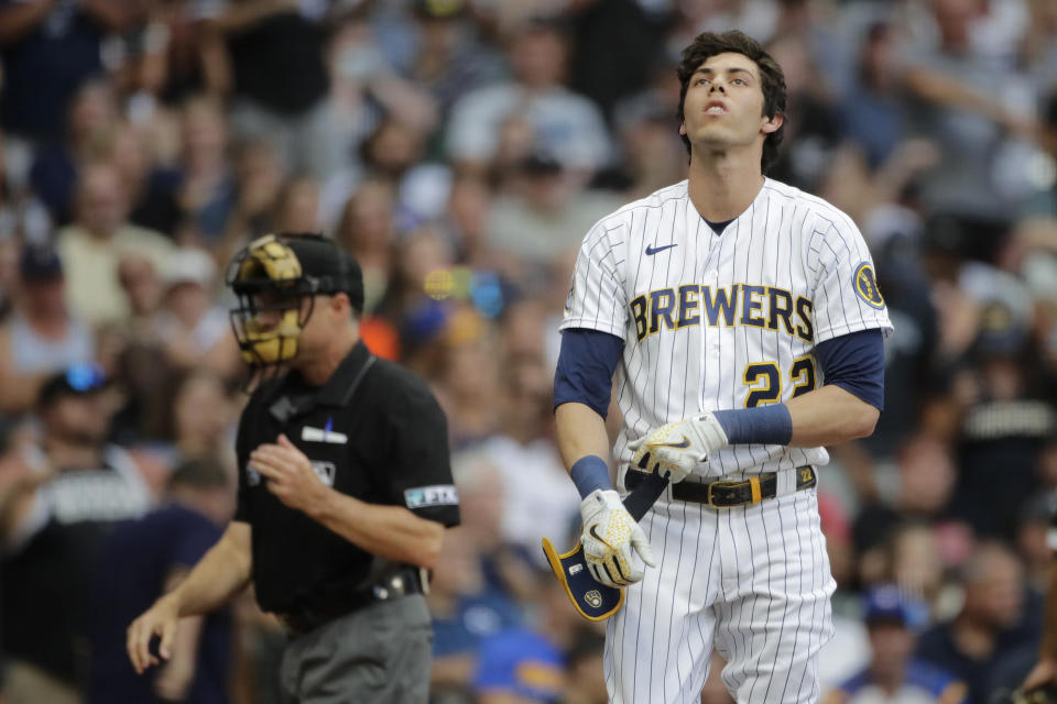 Milwaukee Brewers' Christian Yelich reacts after striking out during the third inning of a baseball game against the Chicago White Sox Sunday, July 25, 2021, in Milwaukee. (AP Photo/Aaron Gash)