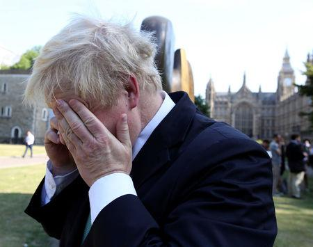 Boris Johnson speaks on the phone in central London, Britain, July 1, 2015. REUTERS/Paul Hackett