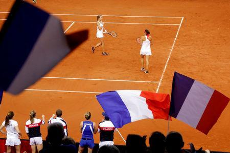 Tennis - Fed Cup - World Group Semi-Final - France v Romania - Kindarena, Rouen, France - April 21, 2019 France's Kristina Mladenovic and Caroline Garcia celebrate during their doubles match against Romania's Simona Halep and Monica Niculescu REUTERS/Charles Platiau