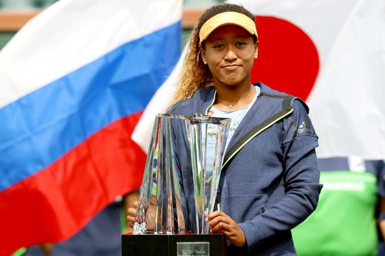 Naomi Osaka of Japan poses with the winer's trophy after defeating Daria Kasatkina of Russia during the women's final at the Indian Wells Tennis Garden