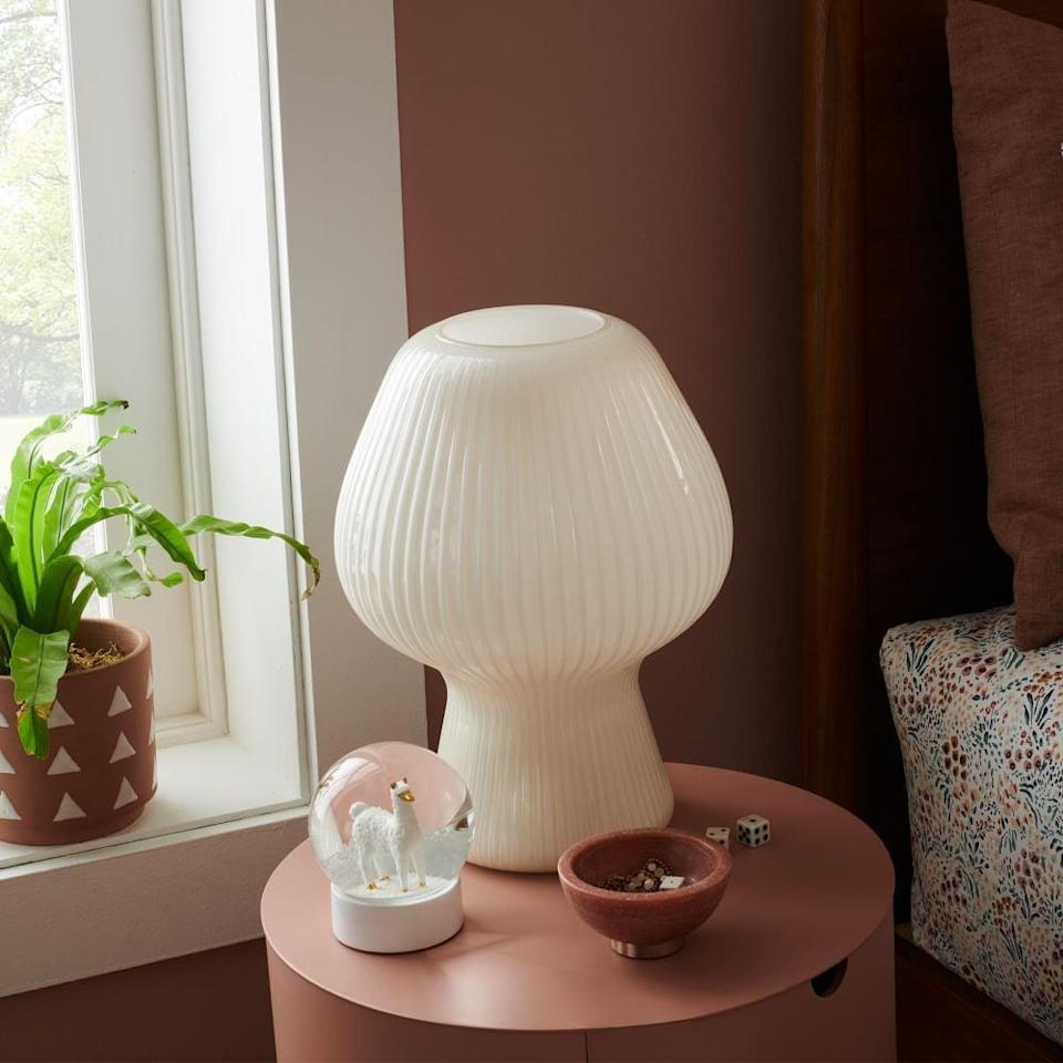 <p>Tap into the mushroom-shaped decor trend with this polished <span>West Elm Ribbed Glass Table Lamp</span> ($159).</p>