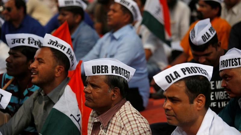 Ola and Uber drivers are seen wearing caps during a protest against Ola and Uber in Mumbai