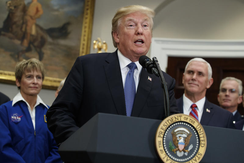 President Donald Trump speaks before signing a policy directive to send American astronauts back to the moon, and eventually Mars, in the Roosevelt Room of the White House, Monday, Dec. 11, 2017, in Washington. From left, NASA astronaut Peggy Whitson, Trump, Vice President Mike Pence, and Vice Chairman of the Joint Chiefs of Staff Gen. Paul J. Selva. (AP Photo/Evan Vucci)