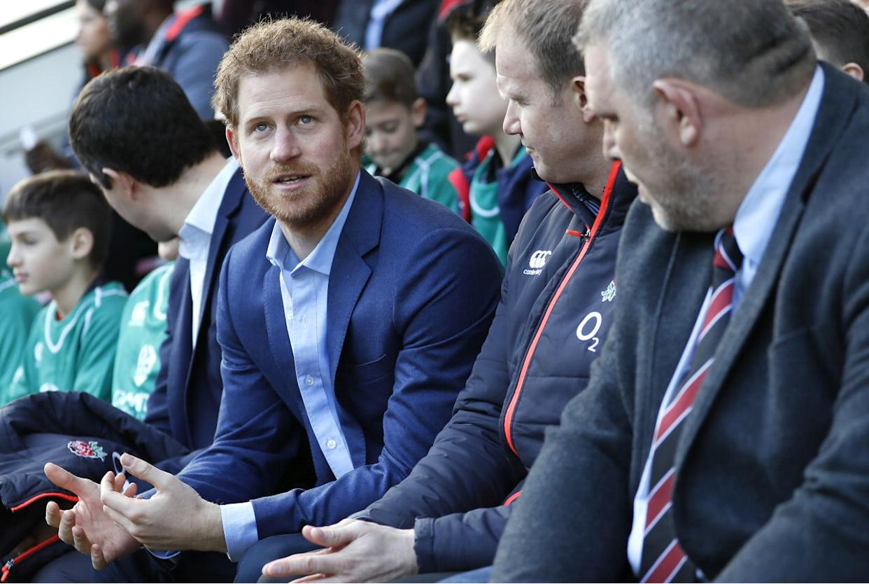 LONDON, ENGLAND - FEBRUARY 17:Britain's Prince Harry speaks with people from the Kids First, Didcot rfc during a visit to an England Rugby Squad training session at Twickenham Stadium on February 17, 2017 in London, England. In his new role as Patron of the Rugby Football Union (RFU), Prince Harry attended the England rugby team open training session. (Photo by Kirsty Wigglesworth - WPA Pool/Getty Images)