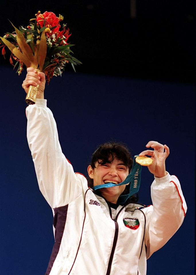 378513 01: Izabela Dragneva of Bulgaria celebrates winning the Gold medal in the Women's 48 kilogram Weightlifting event at the Sydney 2000 Olympic Games September 17, 2000 in Sydney, Australia. (Photo by Clive Brunskill/Allsport)