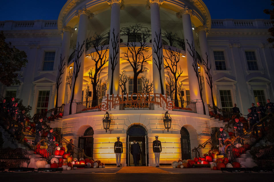 FILE - In this Oct. 28, 2019 file photo, President Donald Trump and first lady Melania Trump depart after giving candy to children during a Halloween trick-or-treat event on the South Lawn of the White House in Washington, which is decorated for Halloween. Melania Trump announced Friday that ghosts and goblins are welcome to trick or treat at the White House on Sunday during a Halloween event that has been rejiggered to include coronavirus precautions. President Donald Trump and the first lady — both recently recovered from COVID-19, the disease brought on by the coronavirus — will welcome guests. (AP Photo/Alex Brandon)