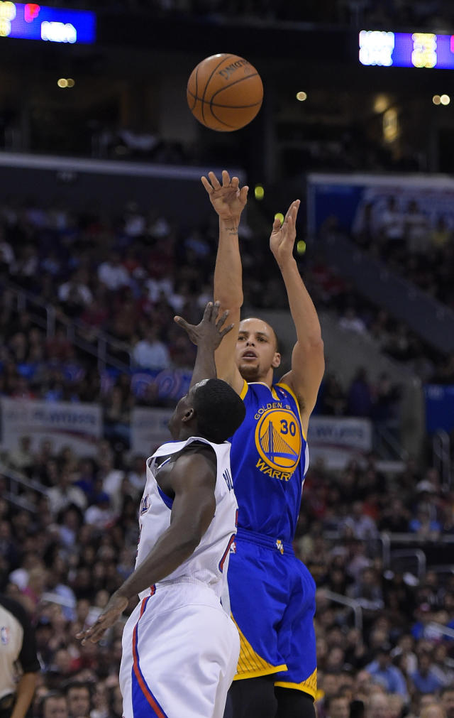 Golden State Warriors guard Stephen Curry, right, puts up a shot as Los Angeles Clippers guard Darren Collison defends during the second half in Game 5 of an opening-round NBA basketball playoff series, Tuesday, April 29, 2014, in Los Angeles. The Clippers won 113-103. (AP Photo)