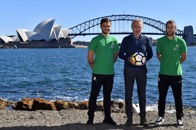 Australia head coach Bert van Marwijk (C, with Josh Risdon and Josh Brillante) has dropped Jamie Maclaren from the World Cup squad (AFP Photo/Saeed KHAN)