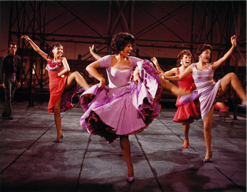"""This photo provided by courtesy of MGM Home Entertainment shows Rita Moreno, center, as Anita, in the 1961 musical, """"West Side Story."""" Moreno won an Academy Award as best supporting actress for her performance. Moreno is the 50th SAG Life Achievement recipient, to be honored at the Screen Actors Guild Awards, Saturday, Jan. 18, 2014, in Los Angeles. (AP Photo/Courtesy MGM Home Entertainment)"""