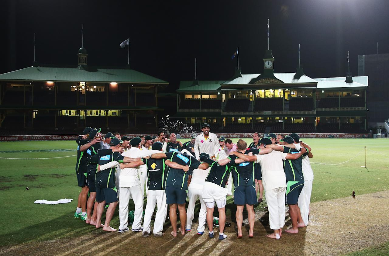 SYDNEY, AUSTRALIA - JANUARY 05:  Nathan Lyon of Australia leads the team song on the pitch at midnight after day three of the Fifth Ashes Test match between Australia and England at Sydney Cricket Ground on January 5, 2014 in Sydney, Australia.  (Photo by Ryan Pierse/Getty Images)