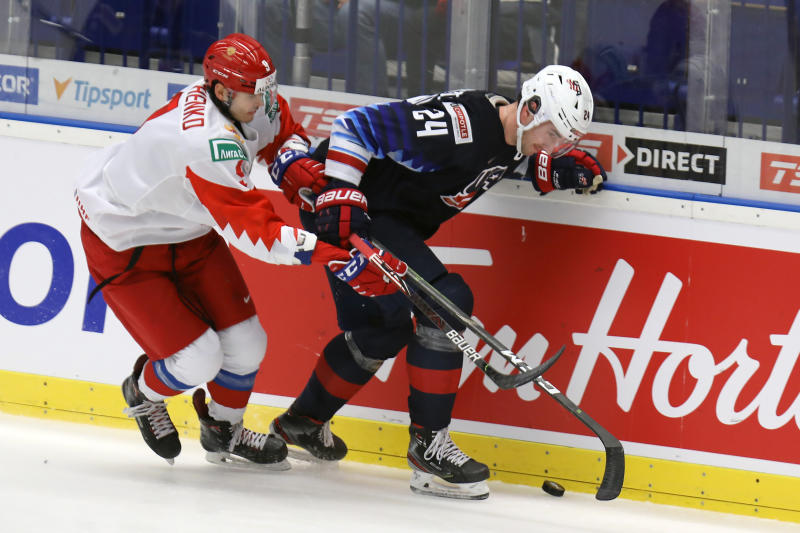 From left Kirill Marchenko of Russia and Mattias Samuelsson of the United States during the 2020 IIHF World Junior Ice Hockey Championships Group B match between USA and Russia in Ostrava, Czech Republic, on Sunday, December 29, 2019. (Petr Sznapka/CTK via AP)