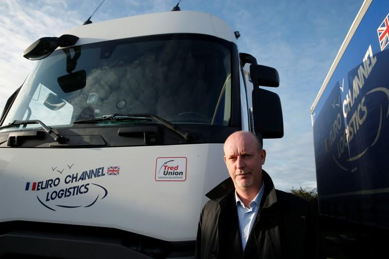 Bruno Beliard, founder and CEO of Euro Channel Logistics, poses in front of his trucks in Dieppe