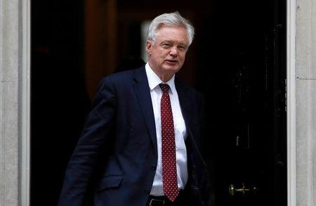 Britain's Secretary of State for Exiting the European Union David Davis leaves Downing Street