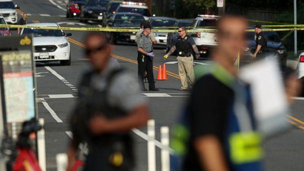 PHOTO: Investigators gather near the scene where fires were shot near where congressmen were gathered, June 14, 2017 in Alexandria, Va. (Alex Wong/Getty Images)