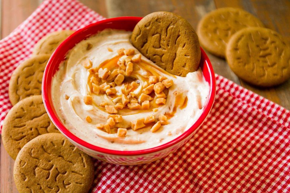 """<p>With swirls of caramel, specks of cinnamon, and sweet toffee pieces, this dip is the perfect welcome-to-fall app.</p><p>Get the recipe from <a href=""""https://www.delish.com/cooking/recipe-ideas/recipes/a44847/caramel-cinnamon-cheesecake-dip-recipe/"""" rel=""""nofollow noopener"""" target=""""_blank"""" data-ylk=""""slk:Delish"""" class=""""link rapid-noclick-resp"""">Delish</a>.</p>"""