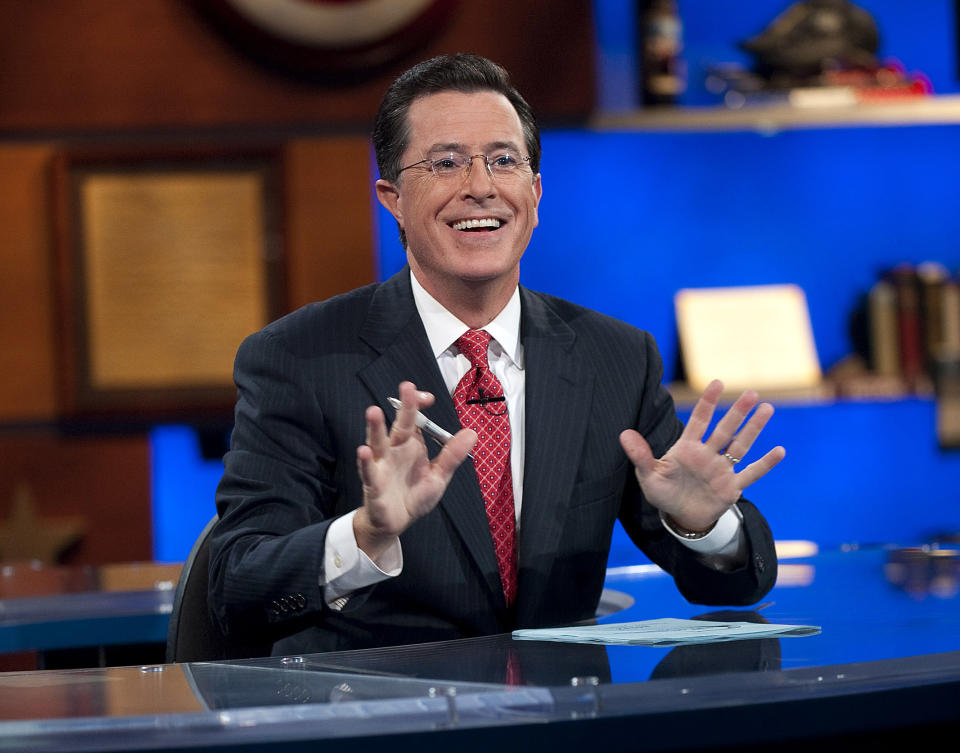 Host Stephen Colbert will sign off from The Colbert Report on Dec. 18, 2014, after nine seasons. (AP Photo/Comedy Central, Scott Gries)