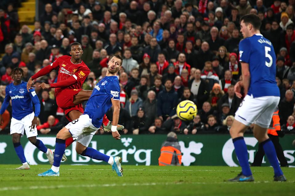 LIVERPOOL, ENGLAND - DECEMBER 04: Georginio Wijnaldum of Liverpool scores his team's fifth goal  during the Premier League match between Liverpool FC and Everton FC at Anfield on December 04, 2019 in Liverpool, United Kingdom. (Photo by Clive Brunskill/Getty Images)
