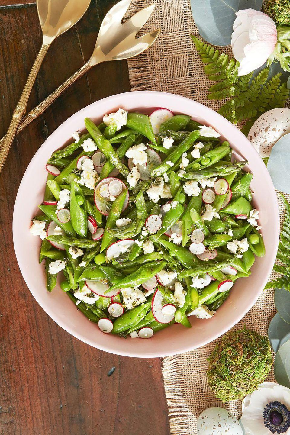 "<p>Even your greens need a hint of cheese—or in this case, a whole block. </p><p><strong><a href=""https://www.countryliving.com/food-drinks/a19041669/asparagus-snap-pea-and-radish-salad-recipe/"" rel=""nofollow noopener"" target=""_blank"" data-ylk=""slk:Get the recipe"" class=""link rapid-noclick-resp"">Get the recipe</a>.</strong></p>"