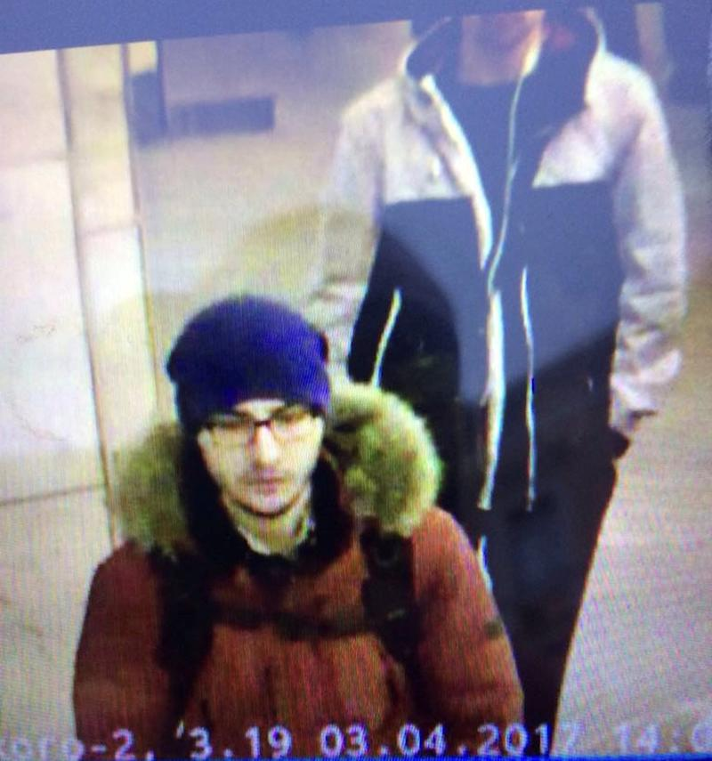 A still image purporting to show Akbarzhon Jalilov walking at a St Petersburg metro station before the blast on Monday - Credit: REUTERS/Handout