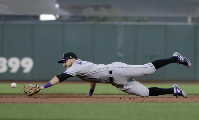 Colorado Rockies shortstop Garrett Hampson cannot get to a ball hit for a single by San Francisco Giants' Donovan Solano during the third inning of a baseball game in San Francisco, Tuesday, June 25, 2019. (AP Photo/Jeff Chiu)